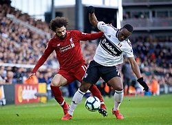 LONDON, ENGLAND - Sunday, March 17, 2019: Liverpool's Mohamed Salah (L) and Fulham's Neeskens Kebano during the FA Premier League match between Fulham FC and Liverpool FC at Craven Cottage. (Pic by David Rawcliffe/Propaganda)