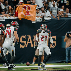 Sep 9, 2018; New Orleans, LA, USA; Tampa Bay Buccaneers safety Justin Evans (21) celebrates after scoring on a fumble return against the New Orleans Saints during the first half of a game at the Mercedes-Benz Superdome. Mandatory Credit: Derick E. Hingle-USA TODAY Sports