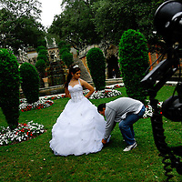 MIAMI, FL -- January 21, 2008 -- Melissa Capote of Miami gets her quinceañera photo taken by Photography by Padilla at Vizcaya Museum & Gardens in Miami, Fla., on Saturday, January 21, 2008.  Agricultural industrialist James Deering built Vizcaya Museum & Gardens in 1916 with ornate gardens and sculpture surrounding the massive main house.