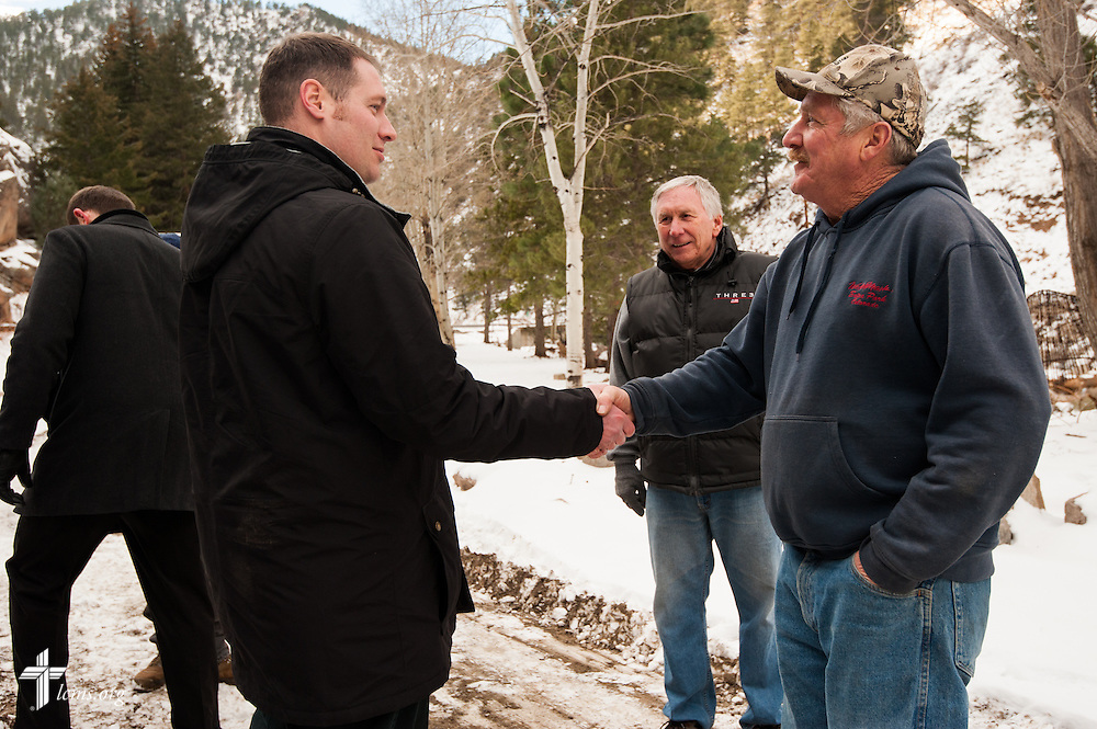 The Rev. Michael W. Meyer, manager of LCMS Disaster Response, is thanked by Richard McGurn, after touring damaged property from the September floods on Tuesday, Jan. 7, 2014, near Estes Park, Colo. LCMS Communications/Erik M. Lunsford