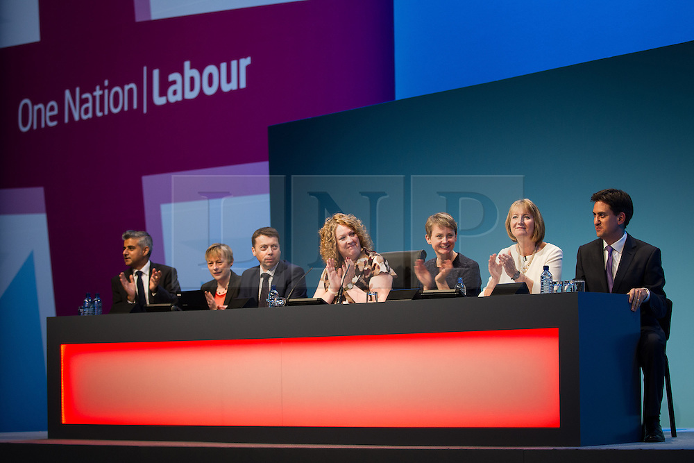 © Licensed to London News Pictures . 25/09/2013 . Brighton , UK . The panel applaud Ed Miliband on the stage before Doreen Lawrence 's speech this afternoon (Wednesday 25th September 2013) . Day 4 of the Labour Party 's annual conference in Brighton . Photo credit : Joel Goodman/LNP