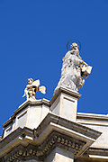 Statue of a Saint and a Cherub on top of the cathedral in Catania, Sicily, Italy