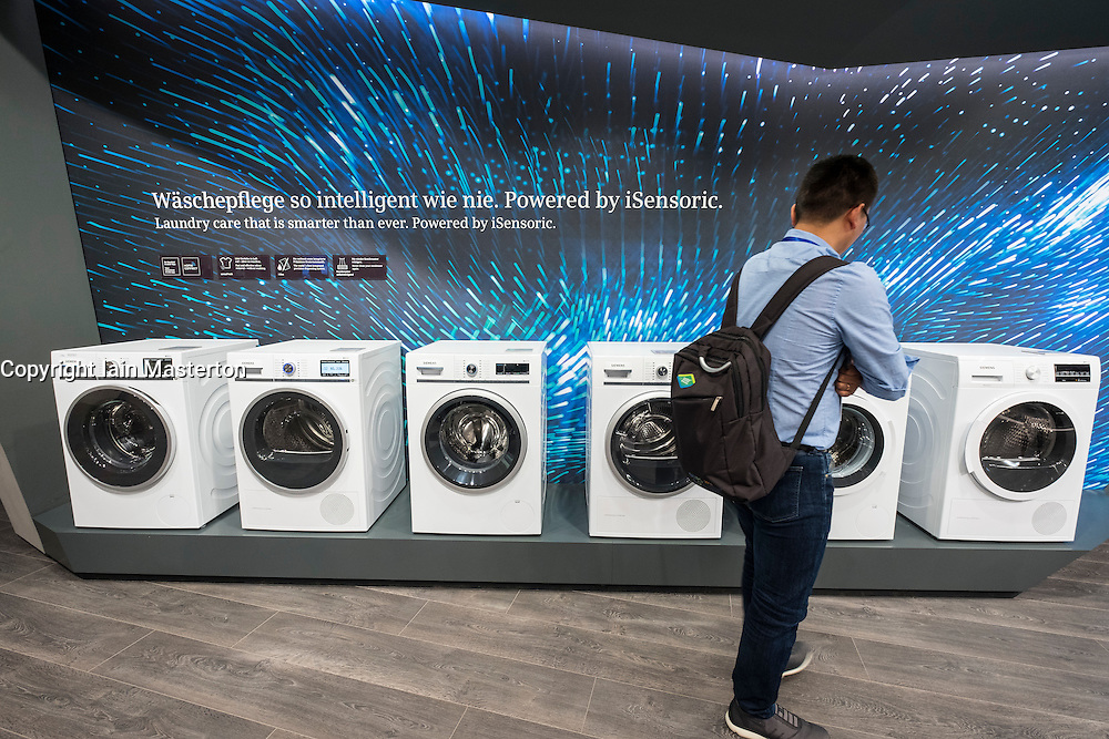 Visitor looking at new Siemens washing machines at 2016  IFA (Internationale Funkausstellung Berlin), Berlin, Germany