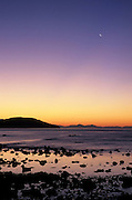 Crecent moon at dawn above Bahia de los Angeles, Baja California, Mexico