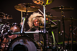 © Licensed to London News Pictures . 15/12/2015 . Manchester , UK . TOMMY ALDRIDGE . Whitesnake perform at the Manchester Arena . Photo credit : LNP