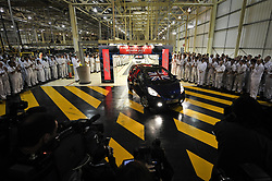 File photo dated 07/10/09 of workers gathered around the first Honda Jazz which rolls off the production line at the Swindon plant in Wiltshire. Honda is planning to close its plant in Swindon in three years time, according to unconfirmed reports.