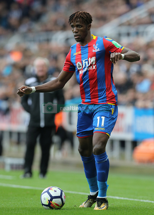 "Crystal Palace's Wilfried Zaha during the Premier League match at St James' Park, Newcastle. PRESS ASSOCIATION Photo. Picture date: Saturday October 21, 2017. See PA story SOCCER Newcastle. Photo credit should read: Owen Humphreys/PA Wire. RESTRICTIONS: EDITORIAL USE ONLY No use with unauthorised audio, video, data, fixture lists, club/league logos or ""live"" services. Online in-match use limited to 75 images, no video emulation. No use in betting, games or single club/league/player publications."