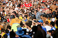 Stewards and police wade into the England fans during the 2014 FIFA World Cup match at Mineir&atilde;o, Belo Horizonte, Brazil. <br /> Picture by Andrew Tobin/Focus Images Ltd +44 7710 761829<br /> 24/06/2014