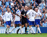 Photo. Glyn Thomas. Digitalsport<br /> Manchester City v Everton. <br /> Barclays Premiership. 11/09/2004.<br /> Evertom players argue with referee Steve Bennett (C) after Tim Cahill was sent off for over-celebrating