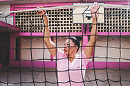 """ANA MARIA CAMPOS II PRISON, MARACAIBO. - December 2018<br /> <br /> A woman inside a """"closed"""" prison in Maracaibo - the border city between Venezuela and Colombia - helps arrange the net to play volleyball. Their schedules include playing sports along with receiving classes, motivational and disciplinary workshops and arts and crafts. The purpose of these centers is to reform women and avoid relapse. They get redemptions if they behave properly to get their sentence reduced."""