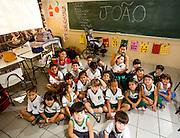 Sao Goncalo do Para_MG, Brasil...Professora com um aluno que sofre de Paralisia Cerebral, a escola flexibilizou o  espaco para receber o estudante e conseguiu uma professora exclusiva para ele...The teacher and a student with cerebral palsy, the school increased the space to receive the student and have a teacher solely for him...Foto: LEO DRUMOND / NITRO