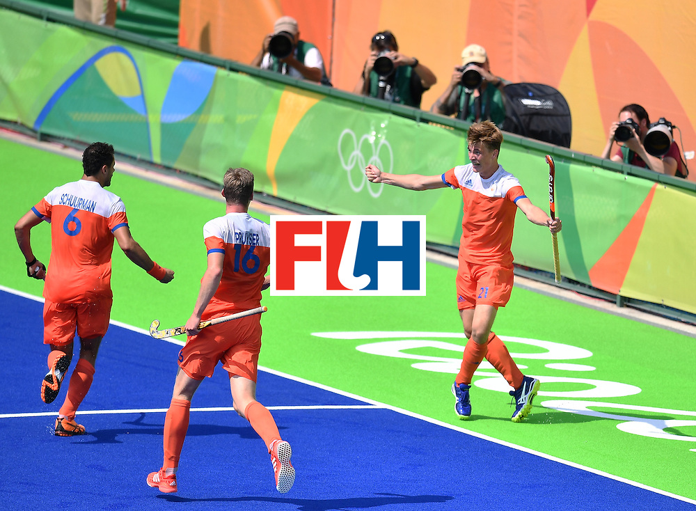 Netherlands' Jorrit Croon (R) celebrates after scoring a goal during the men's Bronze medal field hockey Netherlands vs Germany match of the Rio 2016 Olympics Games at the Olympic Hockey Centre in Rio de Janeiro on August 18, 2016. / AFP / MANAN VATSYAYANA        (Photo credit should read MANAN VATSYAYANA/AFP/Getty Images)