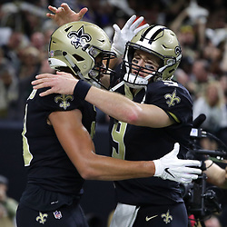 Jan 13, 2019; New Orleans, LA, USA; New Orleans Saints wide receiver Keith Kirkwood (18) celebrates with quarterback Drew Brees (9) after catching a touchdown  pass against the Philadelphia Eagles during the second quarter of a NFC Divisional playoff football game at Mercedes-Benz Superdome. Mandatory Credit: Derick E. Hingle-USA TODAY Sports