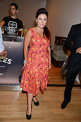 Actress JESSIE WALLACE at a private view of the late Ian Dury's artwork entitled Ian Dury: More Than Fair – Paintings, drawings and artworks, 1961–1972 held at the Royal College of Art, Kensington Gore, London SW7 on 22nd July 2013.