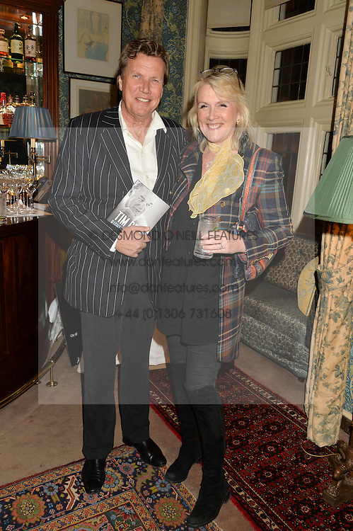 THEO & LOUISE FENNELL at a party to celebrate the publication of Right or Wrong: The Memoirs of Lord Bell held at Mark's Club, Charles Street, London on 16th October 2014.