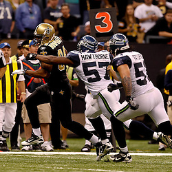 November 21, 2010; New Orleans, LA, USA; New Orleans Saints tight end Tory Humphrey (84) runs away from Seattle Seahawks linebacker David Hawthorne (57) and linebacker Lofa Tatupu (51) during the second half at the Louisiana Superdome. The Saints defeated the Seahawks 34-19. Mandatory Credit: Derick E. Hingle