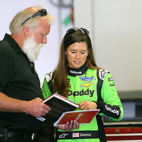 Danica Patrick, driver of the #7 GoDaddy Chevrolet speaks with a crew member during practice for the 60th Annual NASCAR Daytona 500 auto race at Daytona International Speedway on Friday, February 16, 2018 in Daytona Beach, Florida.  (Alex Menendez via AP)