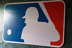 OAKLAND, CA - SEPTEMBER 05: Detailed view of a Major League Baseball logo hanging in a tunnel to the dugout before the game between the Oakland Athletics and the Houston Astros at O.co Coliseum on September 5, 2013 in Oakland, California. The Houston Astros defeated the Oakland Athletics 3-2. (Photo by Jason O. Watson/Getty Images) *** Local Caption ***