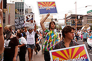 04/25/12-  Andy DeLisle.Protestors chant in the March for Justice against SB 1070 aon Wednesday April, 25 2012 in Phoenix, AZ.