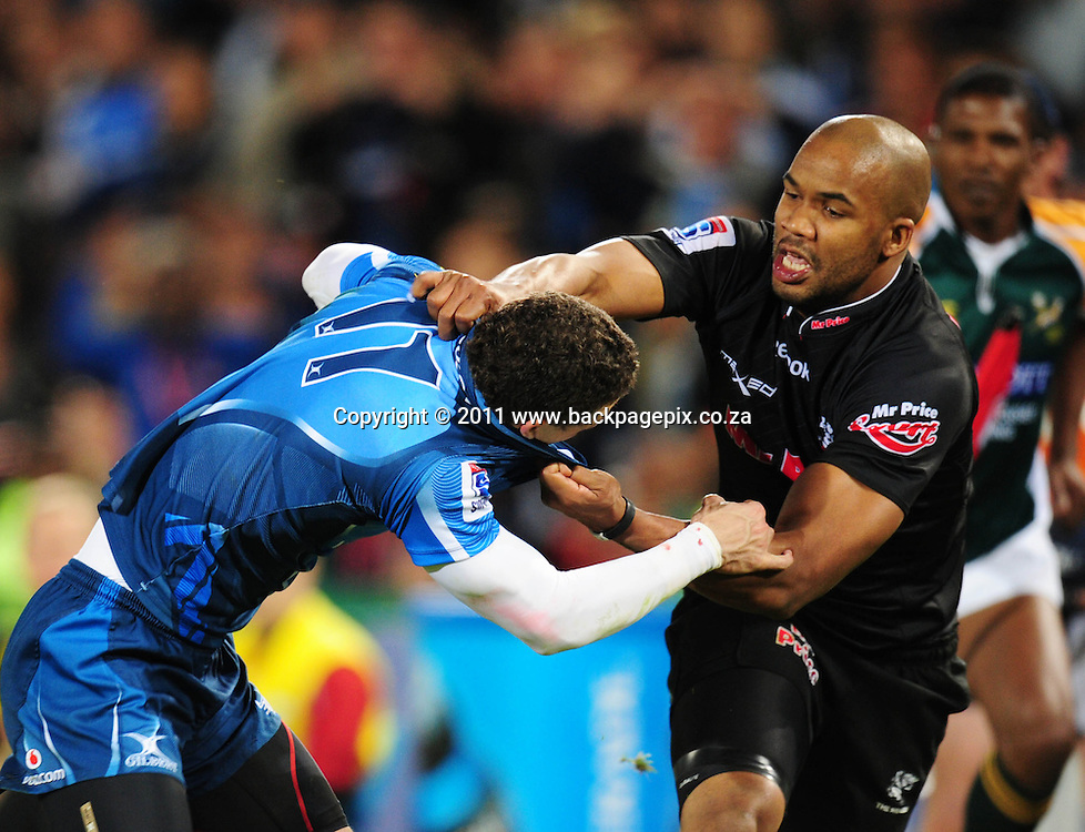 JP Pietersen of the Sharks tackles Bjorn Basson of the Bulls <br /> &copy; Barry Aldworth/Backpagepix