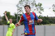 Jake Gray looks on in disbeleive at the decision during the U21 Professional Development League match between Crystal Palace U21s and Huddersfield U21s at Imperial Fields, Tooting, United Kingdom on 7 September 2015. Photo by Michael Hulf.