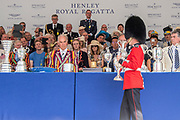 Henley on Thames, England, United Kingdom, 7th July 2019, Henley Royal Regatta, a detachment from the Coldstream Guards March the King's Cup to the presentation podium, Prize Giving ceremony, Prize Giver, Pete REED, Lt Commander, RN.,  Henley Reach, [© Peter SPURRIER/Intersport Image]<br /> <br /> 17:08:24 1919 - 2019, Royal Henley Peace Regatta Centenary,