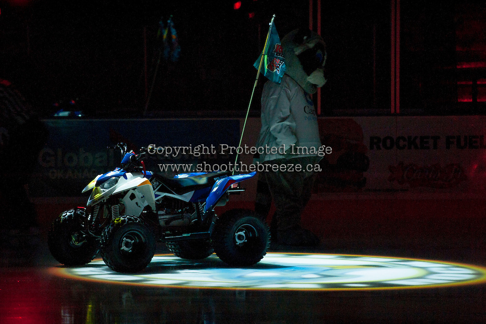 KELOWNA, CANADA - NOVEMBER 6: Rocky Racoon, the Kelowna Rockets mascot, stands on the ice with his Polaris quad at the start of the game against the Red Deer Rebels on NOVEMBER 6, 2013 at Prospera Place in Kelowna, British Columbia, Canada.   (Photo by Marissa Baecker/Shoot the Breeze)  ***  Local Caption  ***