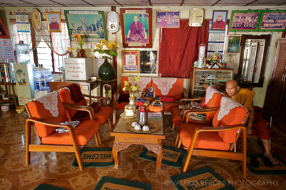Monk sits alone in a common room of a monastery surrounded by objects and images of monastic life. Celibacy is of primary importance in monastic discipline, seen as being the preeminent factor in separating the life of a monastic from that of a householder.