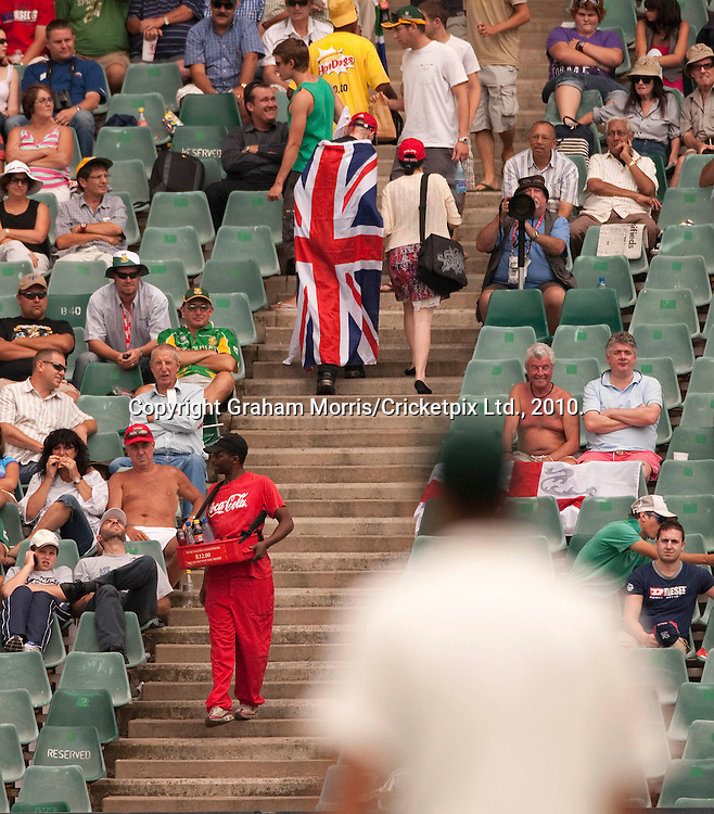 England fans leaving as their team is bowled out during the fourth and final Test Match between South Africa and England at the Wanderers Stadium, Johannesburg. Photograph © Graham Morris/cricketpix.com (Tel: +44 (0)20 8969 4192; Email: sales@cricketpix.com)