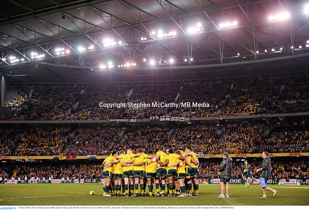 29 June 2013; The Australia team huddle ahead of the game. British & Irish Lions Tour 2013, 2nd Test, Australia v British & Irish Lions. Ethiad Stadium, Docklands, Melbourne, Australia. Picture credit: Stephen McCarthy / SPORTSFILE