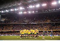 29 June 2013; The Australia team huddle ahead of the game. British & Irish Lions Tour 2013, 2nd Test, Australia v British & Irish Lions. Ethiad Stadium, Docklands, Melbourne, Australia. Picture credit: Stephen McCarthy / SPORTSFILE