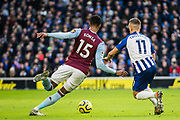 Ezri Konsa (Aston Villa) & Leondro Trossard (Brighton) both after the ball during the Premier League match between Brighton and Hove Albion and Aston Villa at the American Express Community Stadium, Brighton and Hove, England on 18 January 2020.