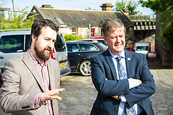 Pictured: Josiah Lockhart and Keith Brown<br /> <br /> Cabinet Secretary for Economy, Jobs & Fair Work Keith Brown visited Gorgie City Farm today  to mark their accreditation as the 800th Living Wage employer in Scotland. Mr Brown met Josiah Lockhart, CEO and undertook a short tour of the farm, celebrating their accreditation and promoting the Living Wage more generally. The Scottish Government has set a target of reaching 1,000 Scottish-based Living Wage Accredited Employers by autumn 2017. While at the farm Mr Brown met Maia Gordon, Kirsty McGoff (17) and Zoe White (18), who have benefited from the living wage, and George Ellis, chair of the farm's board of directors<br /> Ger Harley | EEm 18 May 2017