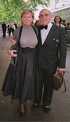 MR & MRS STIRLING MOSS he is the racing driver, at a party in London on 5th June 1999.MSX 29