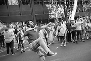 Football fans  playing football on  Charing Cross Rd.  after England won their game against Sweded,  2018, Soho, London. 7 July 2018