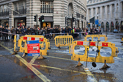 © licensed to London News Pictures. London, UK 02/03/2013. Regent Street closed to the traffic after a Thames Water pipe leaking water to the famous shopping street in London on Saturday 02 March 2013. Photo credit: Tolga Akmen/LNP