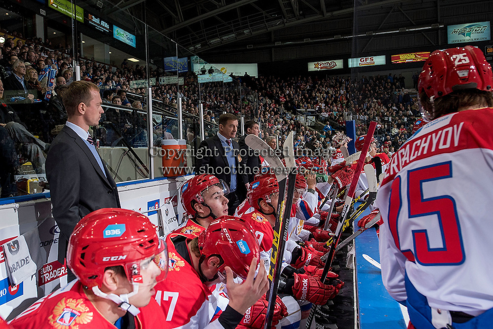 KELOWNA, CANADA - NOVEMBER 9: Valery Bragin, head coach of Team Russia stands on the bench during the time out against the Team WHL on November 9, 2015 during game 1 of the Canada Russia Super Series at Prospera Place in Kelowna, British Columbia, Canada.  (Photo by Marissa Baecker/Western Hockey League)  *** Local Caption *** Valery Bragin;