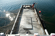 PRICE CHAMBERS / NEWS&amp;GUIDE<br /> Andy Stuth makes preparations for unloading a trap net on the back of the Northwester fishing boat on Yellowstone Lake.