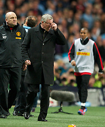 MANCHESTER, ENGLAND - Monday, April 30, 2012: Manchester United manager Sir Alex Ferguson looks dejected during the Premiership match at the City of Manchester Stadium. (Pic by Chris Brunskill/Propaganda)