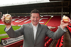 Sheffield United Manager Danny Wilson tucks into his perfect Yummy Mummy cupcake recipe support of childrenÕs cancer charity CLIC Sargent on Wednesday afternoon at the blades home ground Bramall Lane ..http://www.pauldaviddrabble.co.uk..22 February 2012 -  Image © Paul David Drabble
