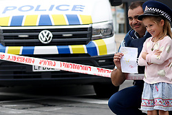 March 17, 2019 - Christchurch, New Zealand - A police officer holds a note give by a little girl and poses for a photograph outside the Linwood Masjid mosque in Christchurch on March 16, 2019. At least 49 people dead and more than 40 people injured following attacks on two mosques in  Christchurch. The national security threat level has been increased from low to high for the first time in New Zealand's history after this attack. (Credit Image: © Sanka Vidanagama/NurPhoto via ZUMA Press)