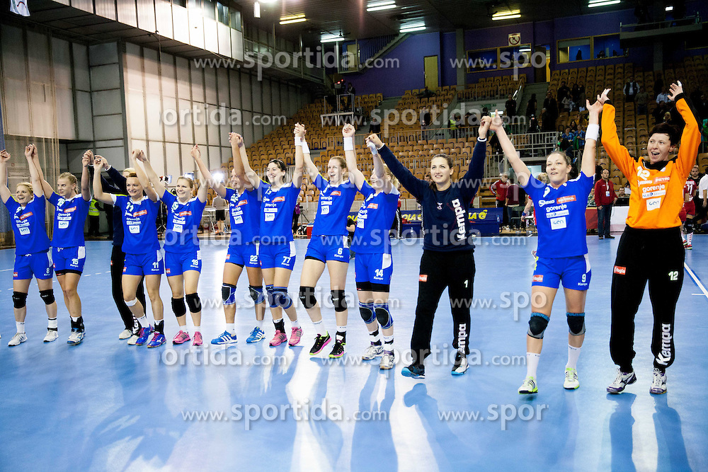 Players of Slovenia celebrate after the handball match between Women National teams of Slovenia and Serbia in 2nd Round of Qualifications for 2014 EHF European Championship on October 27, 2013 in Hala Tivoli, Ljubljana, Slovenia. Slovenia defeated Serbia 31-26. (Photo by Vid Ponikvar / Sportida)