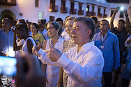 Cartagena de Indias, Bol&iacute;var, Colombia - 25.09.2016        <br /> <br /> The Colombian Juan Manuel Santos walks through the City and speaks with participants of a peace  gathering. Evening before the peace treaty will get signed between the FARC and the Colombian government in Cartagena. On 2nd October follows a peace referendum takes place about the end of the 52 years ongoing civil war between the marxist FARC-EP guerrilla and the government.<br /> <br /> Der kolumbianische Praesident Juan Manuel Santos geht durch die Stra&szlig;en von Cartagena und begruesst die Teilnehmer einer Friedenskundgebung. Abend vor der Friedensvertragsunterzeichnung zwischen der FARC und der kolumbianische Regierung in Cartagena. Am 02. Oktober folgt eine Volksabstimmung &uuml;ber das Ende des seit 52 Jahren dauernden B&uuml;rgerkrieges zwischen der marxistischen FARC-EP Guerilla und der Regierung statt.<br /> <br /> Photo: Bjoern Kietzmann