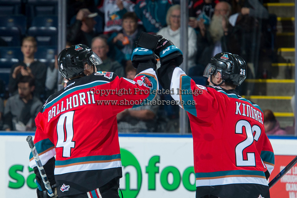 KELOWNA, CANADA - NOVEMBER 17: Gordie Ballhorn #4 and Liam Kindree #26 of the Kelowna Rockets celebrate a first period goal against the Lethbridge Hurricanes on November 17, 2017 at Prospera Place in Kelowna, British Columbia, Canada.  (Photo by Marissa Baecker/Shoot the Breeze)  *** Local Caption ***