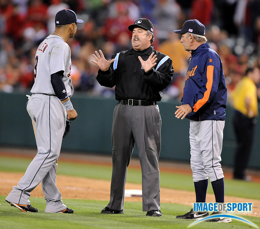 May 26, 2008; Anaheim, CA, USA; Detroit Tigers manager Jim Leyland (10), right, and third baseman Carlos Guillen (9), left, argue a balk call with first base umpire Tim Tschida (4) in the 10th inning against the Los Angeles Angels at Angel Stadium. Mandatory Credit: Kirby Lee/Image of Sport-US PRESSWIRE