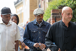 © Licensed to London News Pictures. 16/08/2017. LONDON, UK. ESA CHARLES, father of Rashan Charles with family members arrives at the opening of the inquest into the death of Rashan Charles at Poplar Coroner's Court in east London. Rashan Charles died after being chased by police in Dalston on 22nd July and his death sparked protests and violent clashes with police officers. No cause of death has yet been determined.  Photo credit: Vickie Flores/LNP