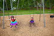 Identical twin sisters Piper and Katie play at an Atlanta, Georgia park in April 2011..