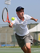 Luther's Aaron Gendron reaches out for the ball during his match against Coe's Jeff Damisch in the Iowa Conference Men's Tennis Championships at Veterans Memorial Tennis Center in Cedar Rapids on Saturday afternoon, May 5, 2012. (Stephen Mally/Freelance)
