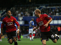 Photo: Lee Earle.<br /> Portsmouth v Manchester United. The FA Barclays Premiership. 15/08/2007.United's Cristiano Ronaldo (L) celebrates with Paul Scholes after he scored their opening goal.