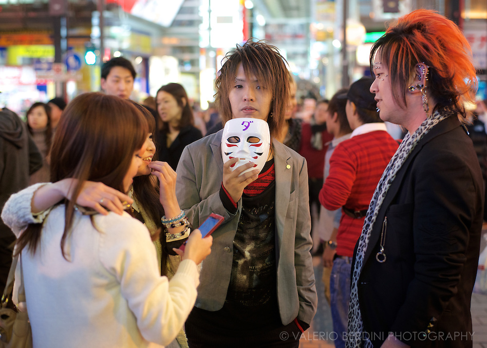 A group of friends have a chat in the Dotonbori super busy shopping arcade. Osaka, Japan 2013
